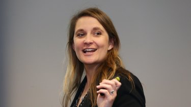 Commonwealth Bank executive Kelly Bayer Rosmarin will leave the bank next month.