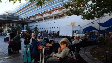 Passengers disembark the Ruby Princess on March 19. The ship has now been the source of 189 COVID-19 cases in NSW, and well over 100 interstate.