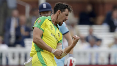 An explosive Mitchell Starc celebrates a wicket.