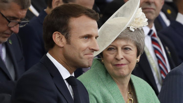 French President Emmanuel Macron and British Prime Minister Theresa May.