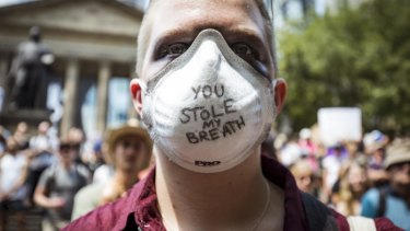 Stealing their thunder?: A climate change protester in Melbourne during the height of the bushfires.