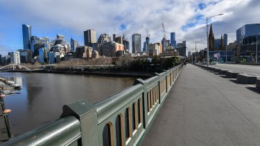 A deserted Princes bridge in Melbourne during the stage four lockdown. Treasurer Josh Frydenberg calculates the shutdown will cost the economy $1 billion a week.