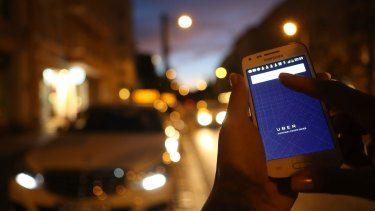 A woman uses a rideshare app.