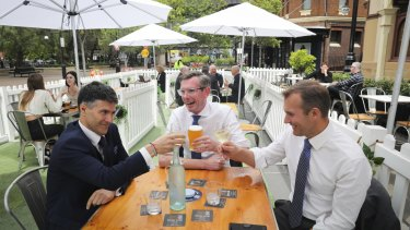 Minister for Customer Service Victor Dominello (left), enjoys a drink with NSW Treasurer Dominic Perrottet and Minister for Planning and Pubic Spaces Rob Stokes in The Rocks.