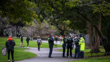 A large group of police at Fitzroy Gardens on Saturday.