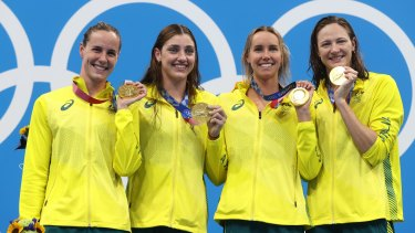 Bronte Campbell, Meg Harris, Emma Mckeon and Cate Campbell of Team Australia pose after winning the gold medal in the Women's 4 x 100m Freestyle Relay Final.