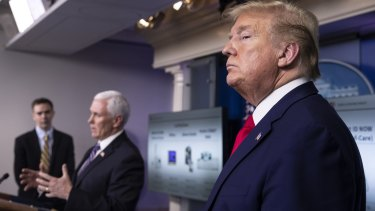 Members of the inner circle of US President Donald Trump, right, and Vice-President Mike Pence, centre, have tested positive for the virus.