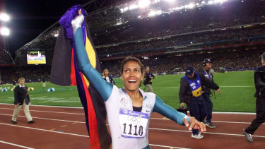 Australia's Cathy Freeman celebrates winning the women's 400-metre race at the Sydney Olympics in 2000.