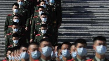 Chinese paramilitary policemen outside the Great Hall of the People last week.