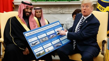 US President Donald Trump shows a chart highlighting arms sales to Saudi Arabia during a meeting with Crown Prince Mohammed bin Salman in the Oval Office in 2018.