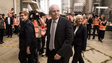 Liberal MP Melissa McIntosh, at right, visits a manufacturing business in her electorate with Prime Scott Morrison. She wants to see Australia get stronger on intellectual property theft.
