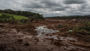 Water and mud from the failed tailings dam at Brumadinho in Brazil. The collapse of another Vale tailings dam and the impact of Cyclone Veronica on the Pilbara miners have removed 100 million tonnes of iron ore from the market this year.