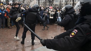A demonstrator clashes with a police officer during a protest against the jailing of opposition leader Alexei Navalny in Russia this year.