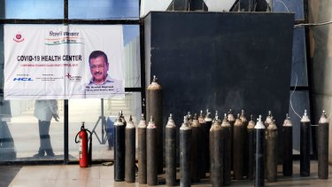 Oxygen tanks outside a ward at the COVID-19 Care Centre set up at the Commonwealth Games Village Sports Complex in New Delhi. There is a shortage of oxygen for patients in hospital and at home.