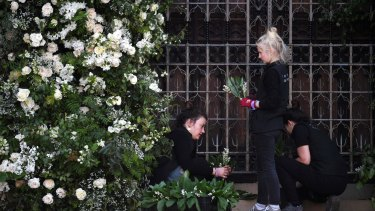Flower arrangers do last-minute preparations within Windsor Castle ahead of the royal wedding ceremony of Britain's Prince Harry and Meghan Markle.