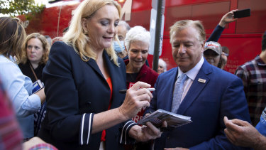 St. Louis-based lawyers Patricia and Mark McCloskey sign autographs outside the Republican campaign office in downtown Scranton, Pennsylvania.