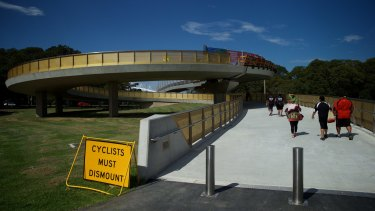 "Pedestrians using the Albert ""Tibby"" Cotter Bridge over Anzac Parade."