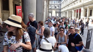 Tourists queueing to enter the Uffizi Gallery in Florence, Italy.