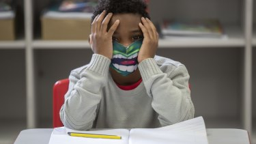 A student wears a mask on the first day back to in-person classes amid the COVID-19 pandemic in Sao Paulo, Brazil. Sao Paulo state government has allowed the schools to resume classes with up to 35 per cent of its students.