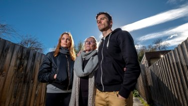 Rien Low with his sister Brooke and mother, Jenny, who had to battle Suncorp Bank.