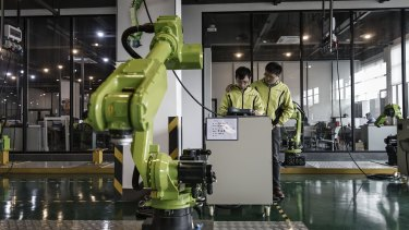 Beijing has rejected pressure from the US to roll back plans for state-led development of robotic and artificial intelligence.