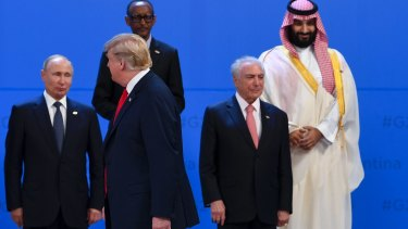 US President Donald Trump walks past Saudi Arabian Crown Prince Mohammad bin Salman, top right, Brazilian President Michel Temer, right, on his last G20 outing, in Buenos Aires last week.