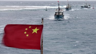 Malaysia's PM Mahathir Mohamad says bigger naval ships in the South China Sea raise the chances of conflict.  Pictured: Chinese fishing boats off the island province of Hainan in the South China Sea.
