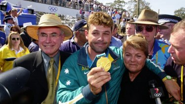 Michael Diamond, pictured with his mum and John Howard, holds his gold medal at the Sydney Games.