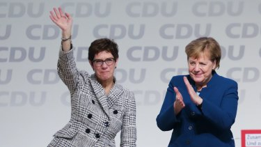 Angela Merkel, Germany's chancellor applauds Annegret Kramp-Karrenbauer, general secretary of the Christian Democrat Union in 2018.