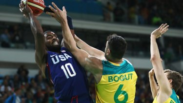 Games on: Kyrie Irving of United States shoots over Andrew Bogut and Ryan Broekhoff of Australia during the Men's Preliminary Round Group A at the Rio Olympics in 2016.