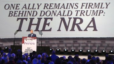 Strong ties: NRA's Chris Cox introduces President Donald Trump at the a Leadership Forum last year.