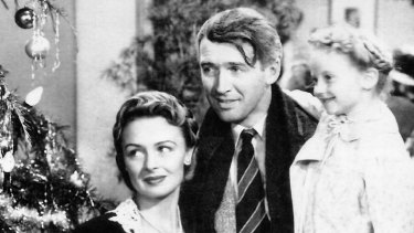 Donna Reed, James Stewart and  Karolyn Grimes in Frank Capra's 1946 film It's a Wonderful Life.