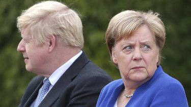 30 days: German Chancellor Angela Merkel welcomes Britain's Prime Minister Boris Johnson for a meeting at the Chancellery in Berlin.