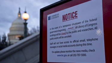 The US Capitol and a temporary shutdown sign outside the Library of Congress in Washington, DC.