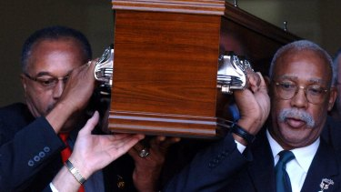 Tommie Smith (left) and John Carlos carry the coffin of Peter Norman from Williamstown Town Hall.