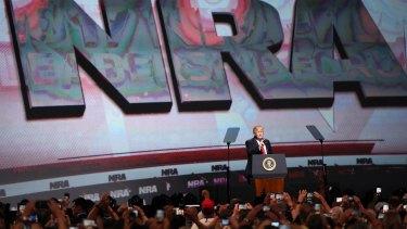 US President Donald Trump speaks at the National Rifle Association Leadership Forum in Atlanta on Friday.