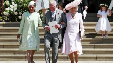 Doria Ragland, mother of the bride, Britain's Prince Charles and Camilla, Duchess of Cornwall following the wedding.