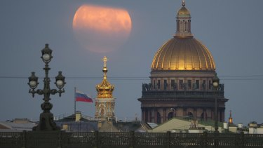 The full moon sets in the clouds over the St. Isaac's Cathedral in St. Petersburg last week.