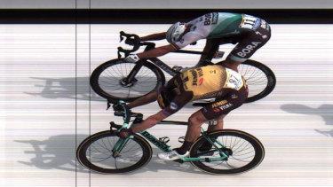 Dutchman Mike Teunissen (below) and Slovakia's Peter Sagan cross the line.