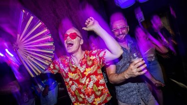 David Butler and Dan Gariepy keeping cool while dancing at the Night Cat in Fitzroy.