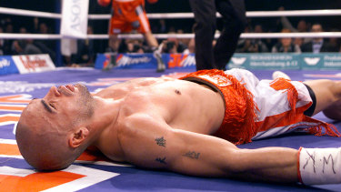Mundine lies unconscious on the canvas after being knocked out by Sven Ottke in 2001.
