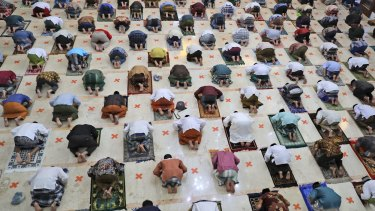 Indonesian Muslims practice social distancing while praying last month.