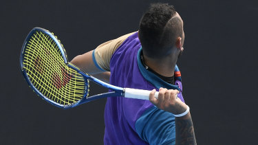 Australia's Nick Kyrgios prepares to throw his racquet into the stands.