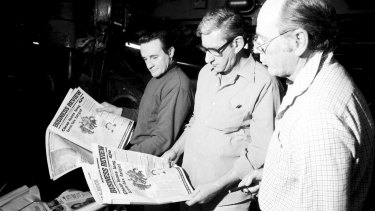 Bob Dempsey, National Times production editor, Evan Whitton, Editor, and Vic Carroll, right, look over the first printing of the National Times Business Review.