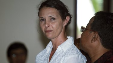 Australian Sara Connor listens to an Indonesian interpreter during her trial in Bali.