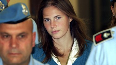 Amanda Knox is escorted by Italian penitentiary police officers to court during her 2008 trial.