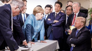 A photograph released by German Chancellor Angela Merkel's office captured the tense relations at the G7 summit.