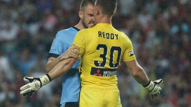 Flashpoint:  Matt Jurman of Sydney FC and Wanderers goalkeeper Liam Reddy face off.