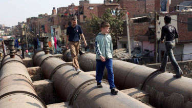 Mark Delaney with his son Tom near their Delhi home in 2009.