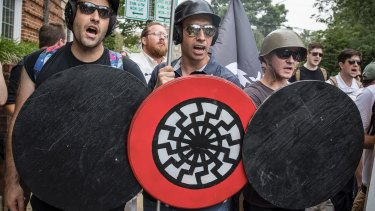 A white supremacist with the black sun on his shield at a Charlottesville  rally in 2017, which turned deadly.